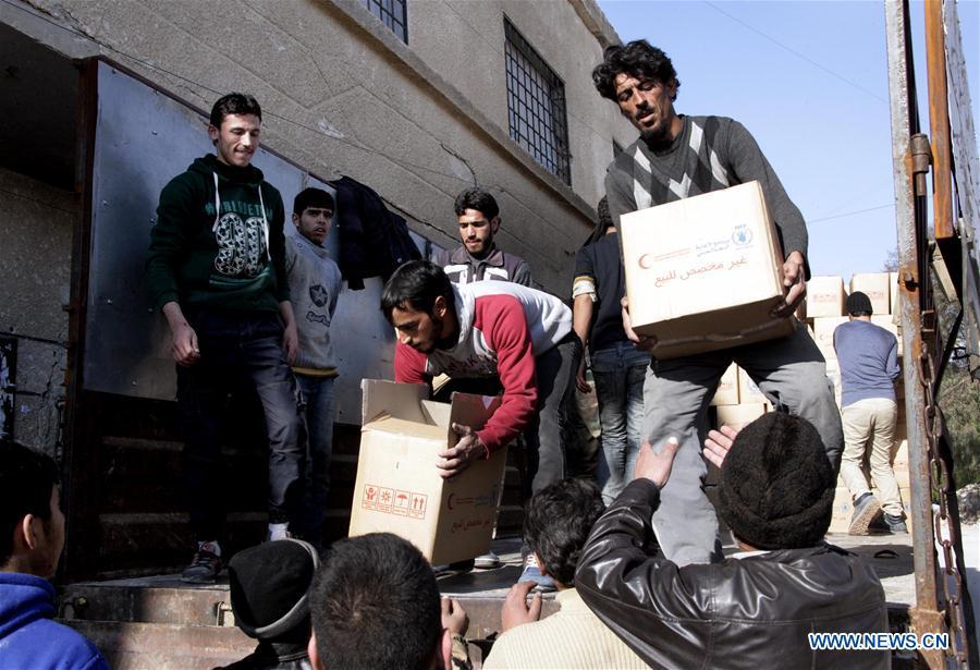 SYRIA-MUADAMIYEH-AID-DELIVERY