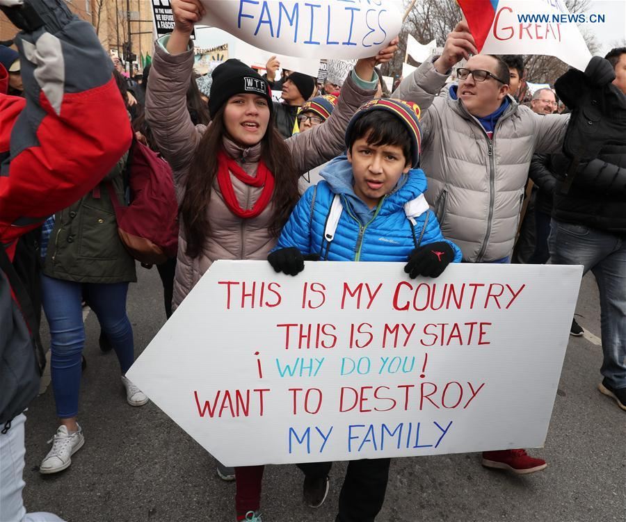 People holding postcards participate in a protest to demonstrate how important immigrants are to America's economy on the Day Without Immigrants at Union Park of Chicago, the United States, Feb. 16, 2017.