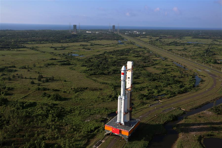 Photo taken on April 17, 2017 shows the cargo spacecraft Tianzhou-1 being transferred with a Long March-7 Y2 carrier rocket from the testing center to the launch zone in Wenchang, south China's Hainan Province. China's first cargo spacecraft Tianzhou-1 is to be launched into space between April 20 and 24, according to the office of China's manned space program. (Xinhua/Zeng Tao)<br/>