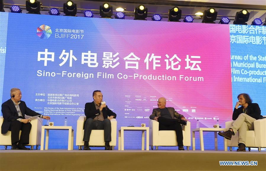 Chinese Director Chen Kaige (2nd L) attends the Sino-Foreign Film Co-Production Forum on the sidelines of the Beijing International Film Festival in Beijing, capital of China, April 17, 2017. (Xinhua/Lu Peng)<br/>