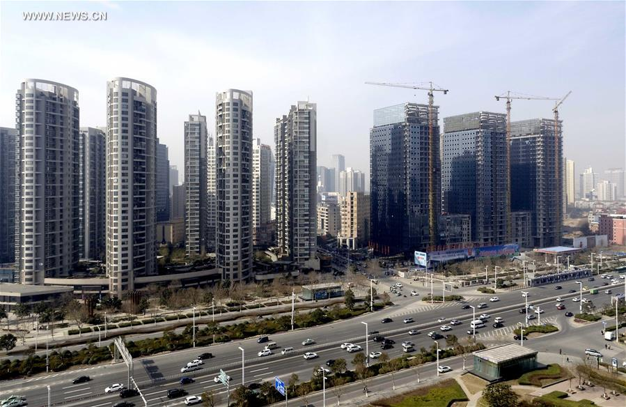 China's home-price growth slows slightly