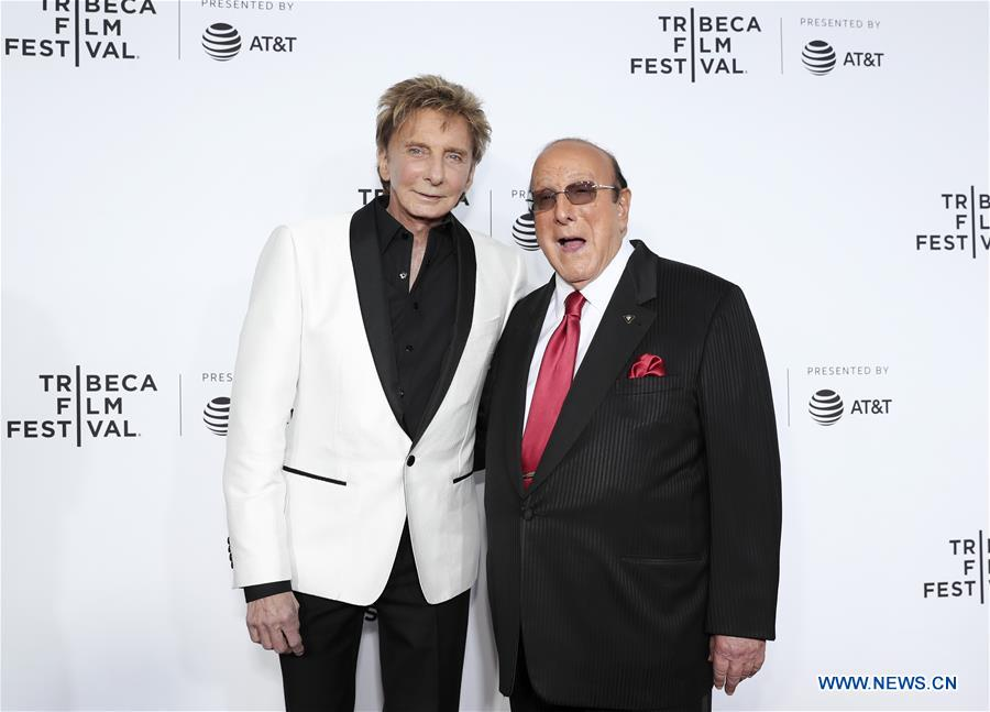 """Singer Barry Manilow (L) and music mogul Clive Davis attend the opening night of the 2017 Tribeca Film Festival and the world premiere of """"Clive Davis: The Soundtrack of Our Lives"""" in New York, the United States, April 19, 2017. The 16th annual Tribeca Film Festival opened here Wednesday night, bringing a trove of films, TV events, virtual reality installations and music pieces to New York. (Xinhua/Wang Ying)"""