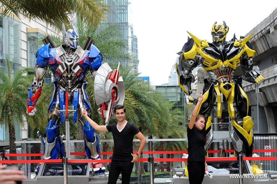 Scale figures of Transformers characters attract tourists in Bangkok
