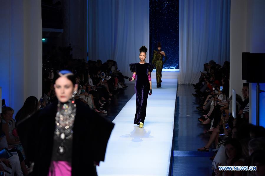 Creations of jean paul gaultier presented in paris france for Haute couture in english