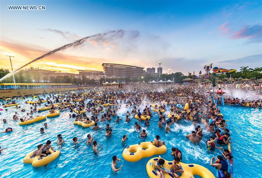 Tourists play in a water park in Wuhan, capital of central China's Hubei Province, July 15, 2017. Days of heat wave drove many citizens to the water park for fun and coolness. (Xinhua/Xiong Qi)<br/>
