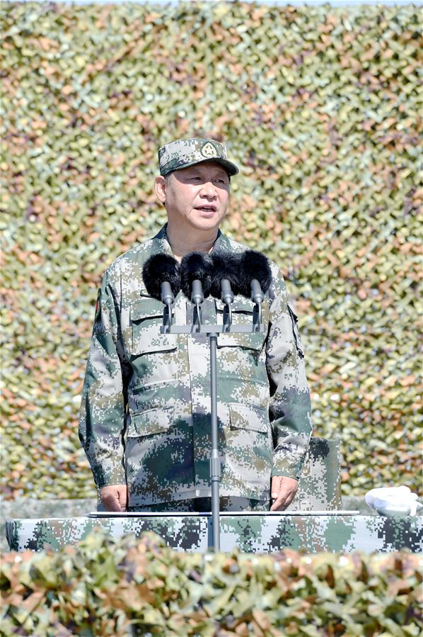 China Focus: Xi reviews parade in field for first time