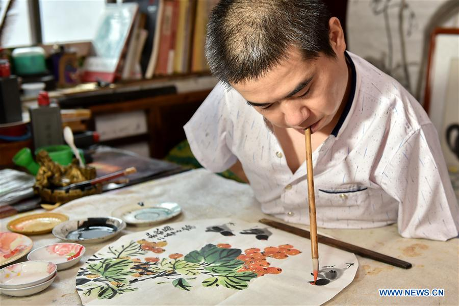 Disabled man learns traditional Chinese art ski