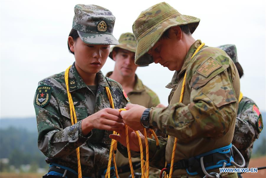 Servicewomen from China and Australia tie knots during a joint military training exercise called &quot;Panda-Kangaroo 2017&quot; in Kunming, capital of southwest China's Yunnan Province, Sept. 12, 2017. The Chinese and Australian armies have concluded the joint military training exercise in China. Ten members from each of the two countries' armies participated in the training, which began on Sept. 10 and concluded Wednesday. (Xinhua/Yang Jicheng)<br/>