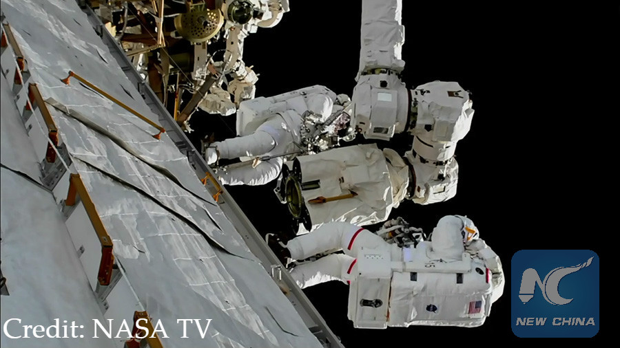 s. astronauts repair robotic arm outside space