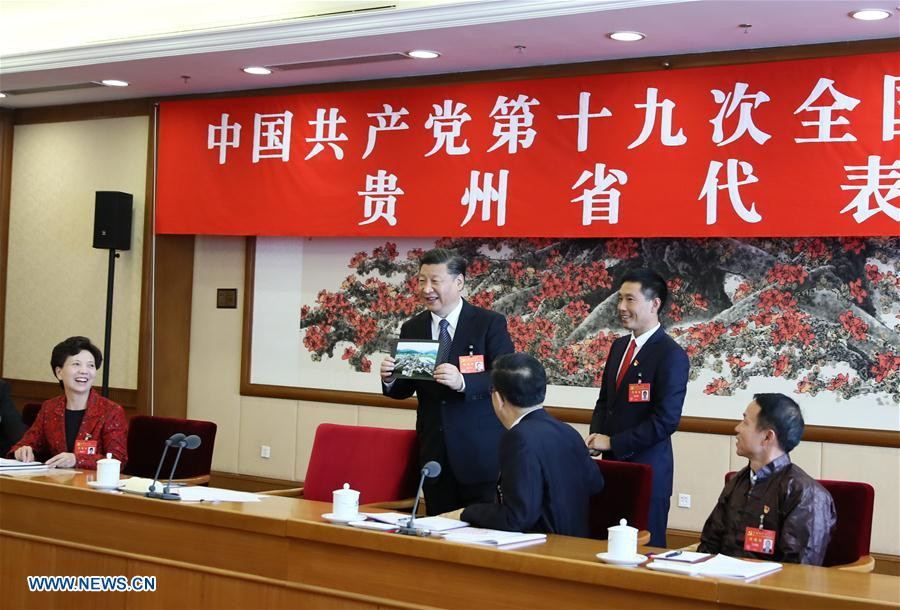 """Feature: Xi """"chews the fat"""" with delegates"""