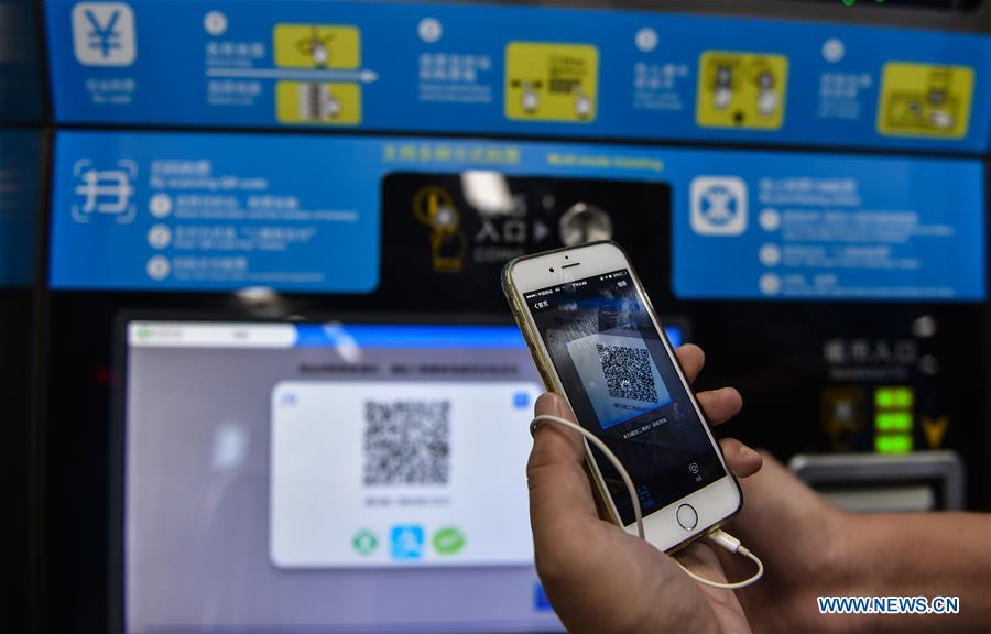 Passengers pay for tickets of subway via WeChat, Alipay in