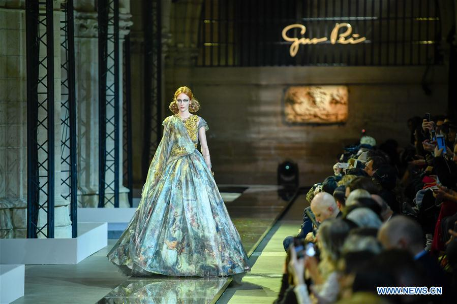 Creations of guo pei 39 s haute couture presented at paris for Haute in english