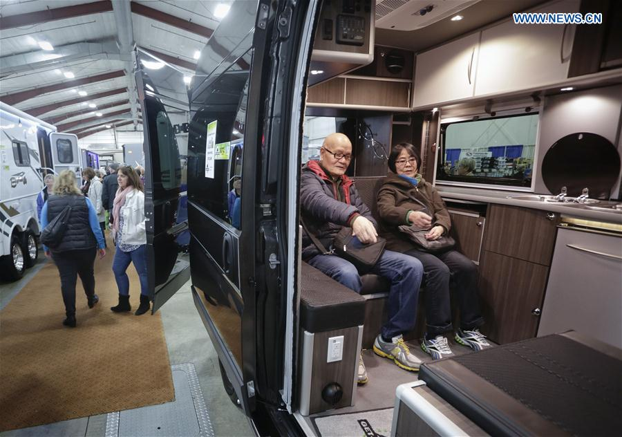 People visit a recreation vehicle during the Earlybird RV Show in Vancouver, Canada, Feb. 17, 2017.