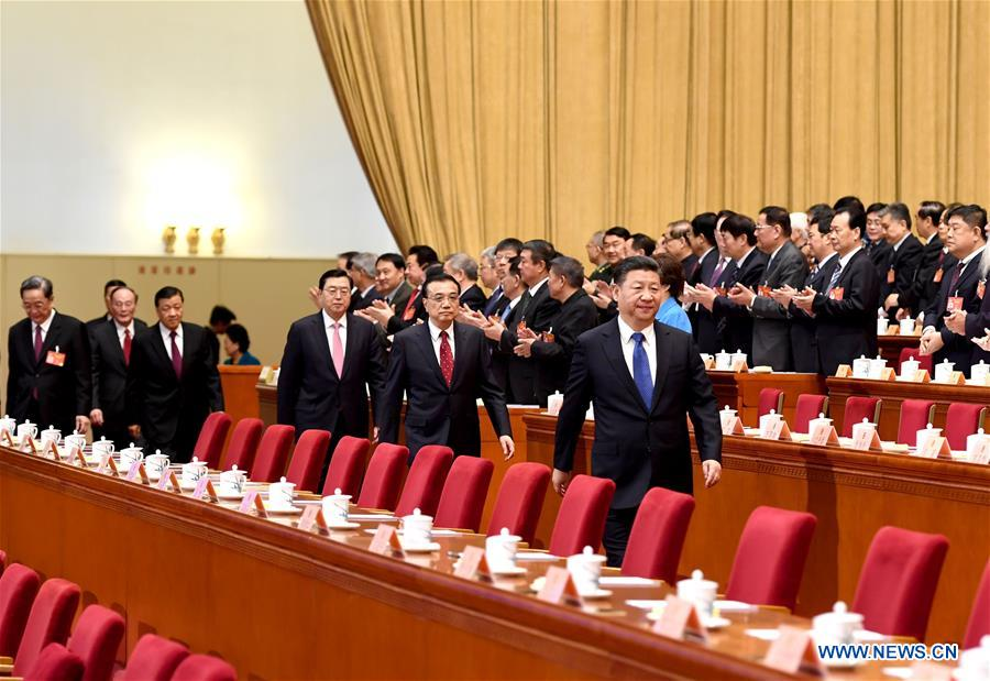 Xi Jinping, Li Keqiang, Zhang Dejiang, Yu Zhengsheng, Liu Yunshan, Wang Qishan and Zhang Gaoli walk onto the rostrum during the closing meeting of the fifth session of the 12th National Committee of the Chinese People's Political Consultative Conference at the Great Hall of the People in Beijing, capital of China, March 13, 2017. (Xinhua/Li Xueren)
