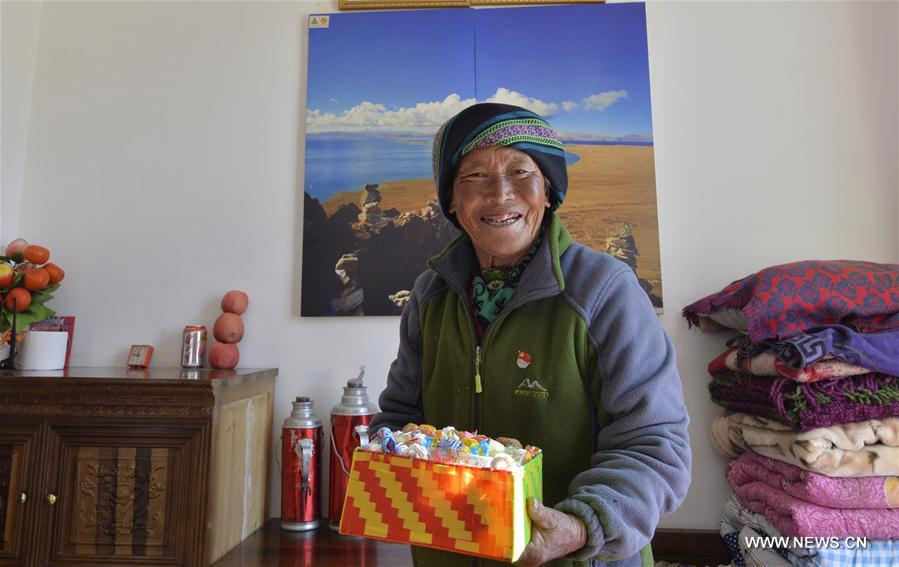 Cering Yangzom, 71, lives at the Jinye nursing home for elders in Dagze County, southwest China's Tibet Autonomous Region, Feb. 14, 2017. A total of 11,400 elders in the region's rural areas have been arranged in nursing homes for better care in recent years. (Xinhua/Purbu Zhaxi)<br/>
