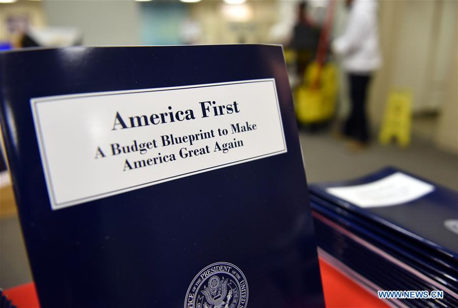 Copies of U.S. President Donald Trump administration's first budget blueprint are seen in Washington D.C., the United States, on March 16, 2017. U.S. President Donald Trump on Thursday unveiled the administration's first budget blueprint which seeks deep cuts across federal departments and agencies in order to fund rising defense spending. (Xinhua/Yin Bogu)<br/>