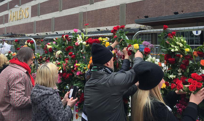 People pay tribute to victims of Stockholm truck attack