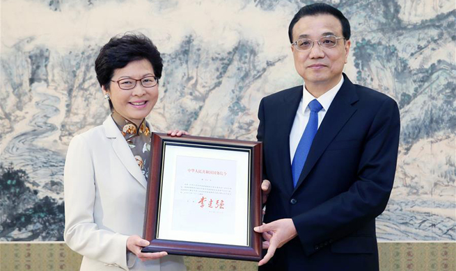 Premier Li grants appointment certificate to incoming HKSAR chief  executive