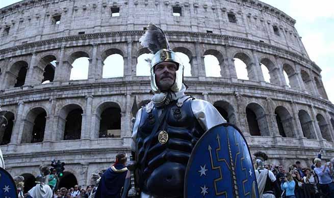 Performers take part in parade to celebrate Birth of Rome