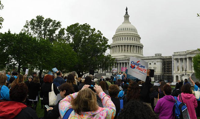 People attend rally raising awareness of child care in Washington