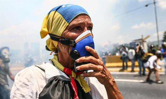 Opposition supporters take part in protest in Venezuela