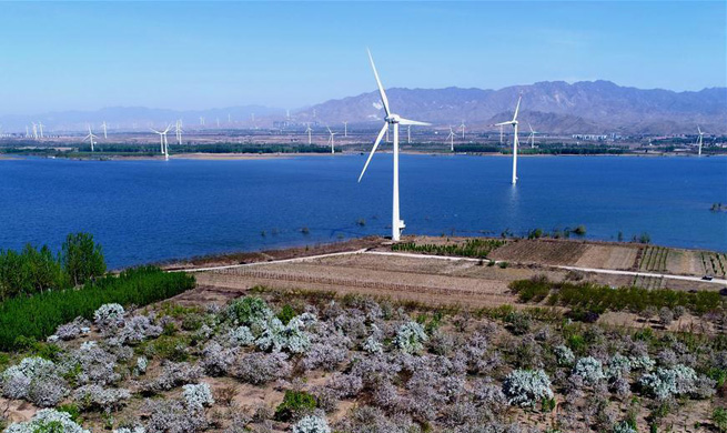 In pics: Wind power generation project in north China