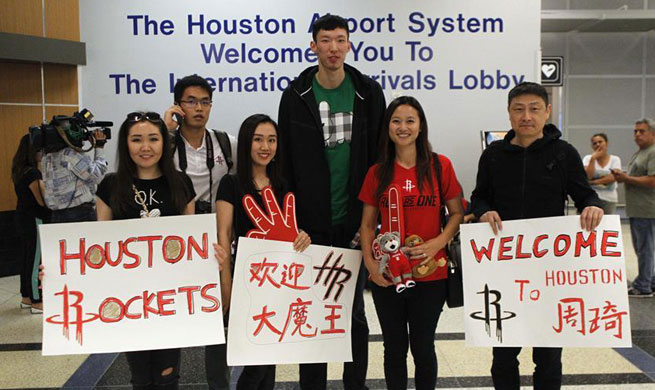 China's basketball player Zhou Qi arrives in Houston