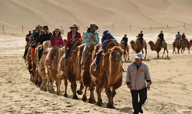 Mingsha Sand Mountain scenery zone in Dunhuang attracts tourists