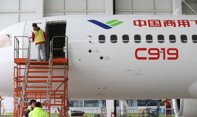 Staff workers check C919 ahead of its maiden flight in Shanghai