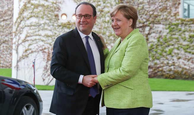 Outgoing French President Hollande meets Merkel in Berlin