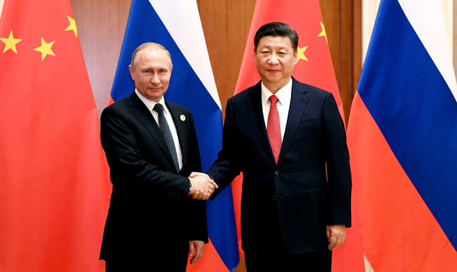 "Xi says China, Russia play role of ""ballast stone"" in world  peace, stability"