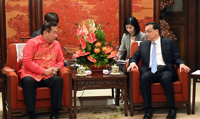 China, Philippines agree to further improve bilateral ties