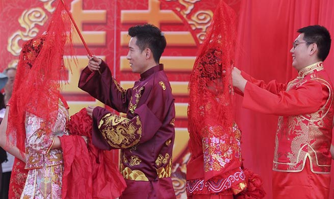 Look of love: Many Chinese couples get married on May 20