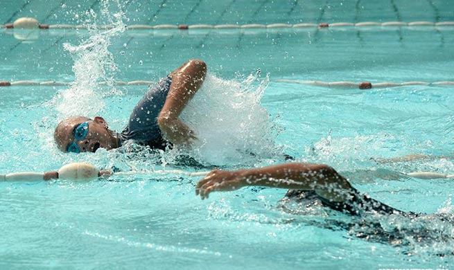 Children take part in 100m freestyle swimming in Indonesia Autism Games