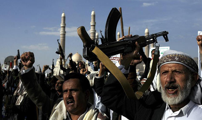 People take part in anti-U.S. protest in Sanaa, Yemen