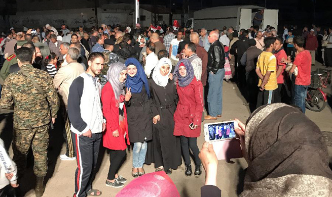 Last batch of rebels evacuate Syria's Homs city