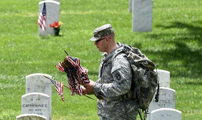 """Flags-In"" ceremony held at Arlington National Cemetery in U.S."