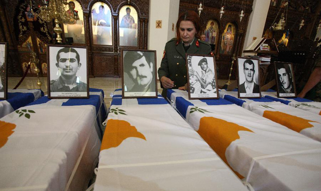 Cyprus hands remains of fallen Greek soldiers to relatives 43 years after their death
