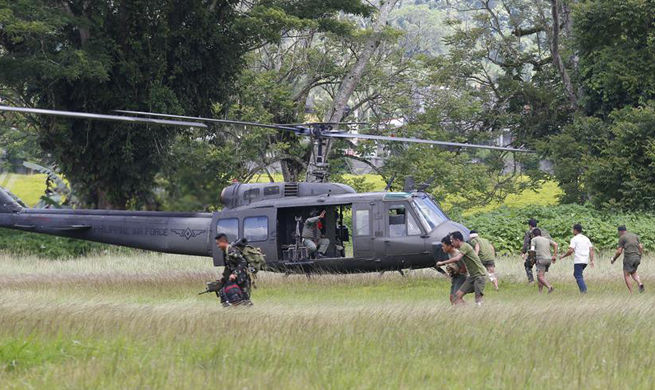 Members of Philippine Marines conduct clearing operation in Marawi