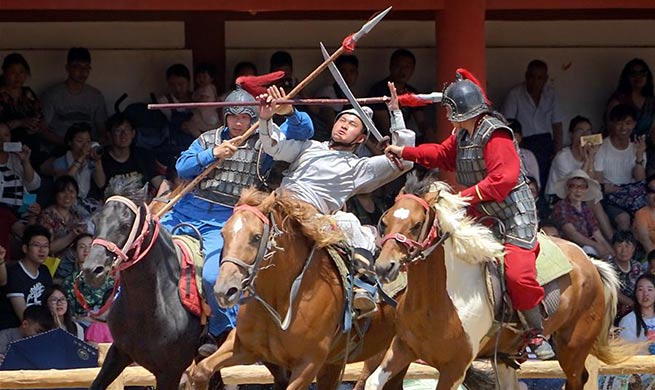 Performers demonstrate sword fighting on horseback in Kaifeng