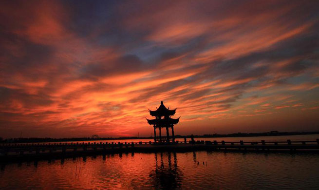 Sunglow scenery seen in Didang Lake of China's Zhejiang