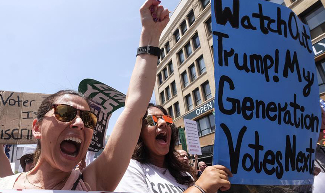 People participate in March for Truth rally in Los Angeles