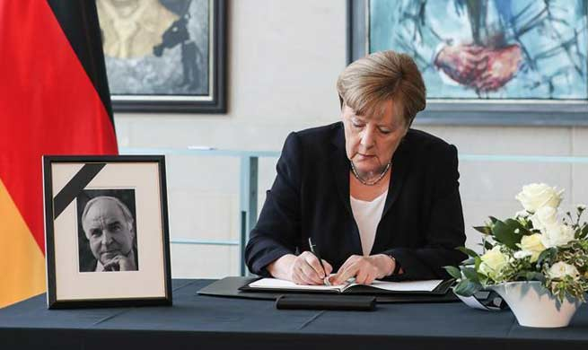 Angela Merkel signs condolences book for former German Chancellor