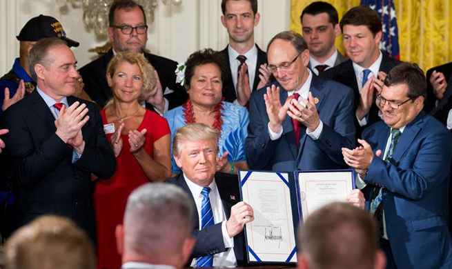 Trump signs new law to protect whistleblowers at Department of Veteran Affairs