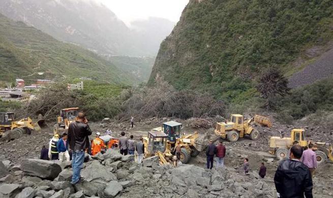 Over 100 buried in southwest China landslide