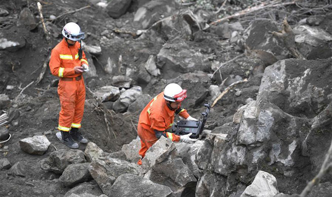 15 taken off missing list in China landslide