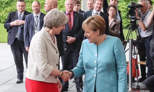 Merkel greets world leaders before preparation meeting for G20