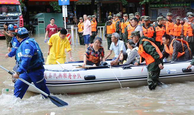 People displaced after continuous heavy rain in C China