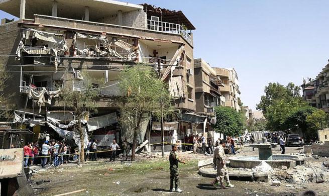 Triple bombings  rock Syria's Damascus