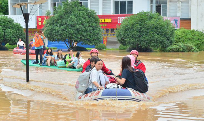16 dead, 94,000 relocated after flood hits south China